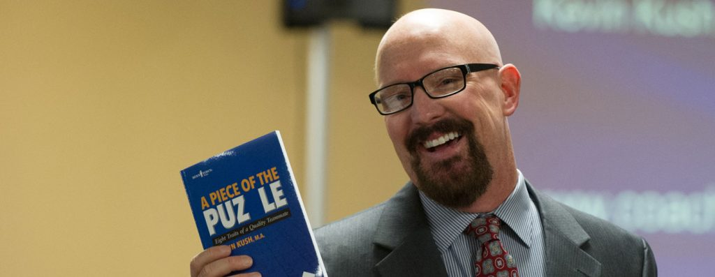 Kevin Kush with book